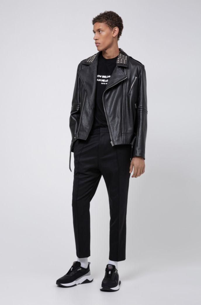 Pantalones extra slim fit en sarga elástica con cintura elástica