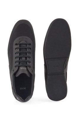 Sneakers mit Mesh-Elementen und reflektierenden Details, Schwarz