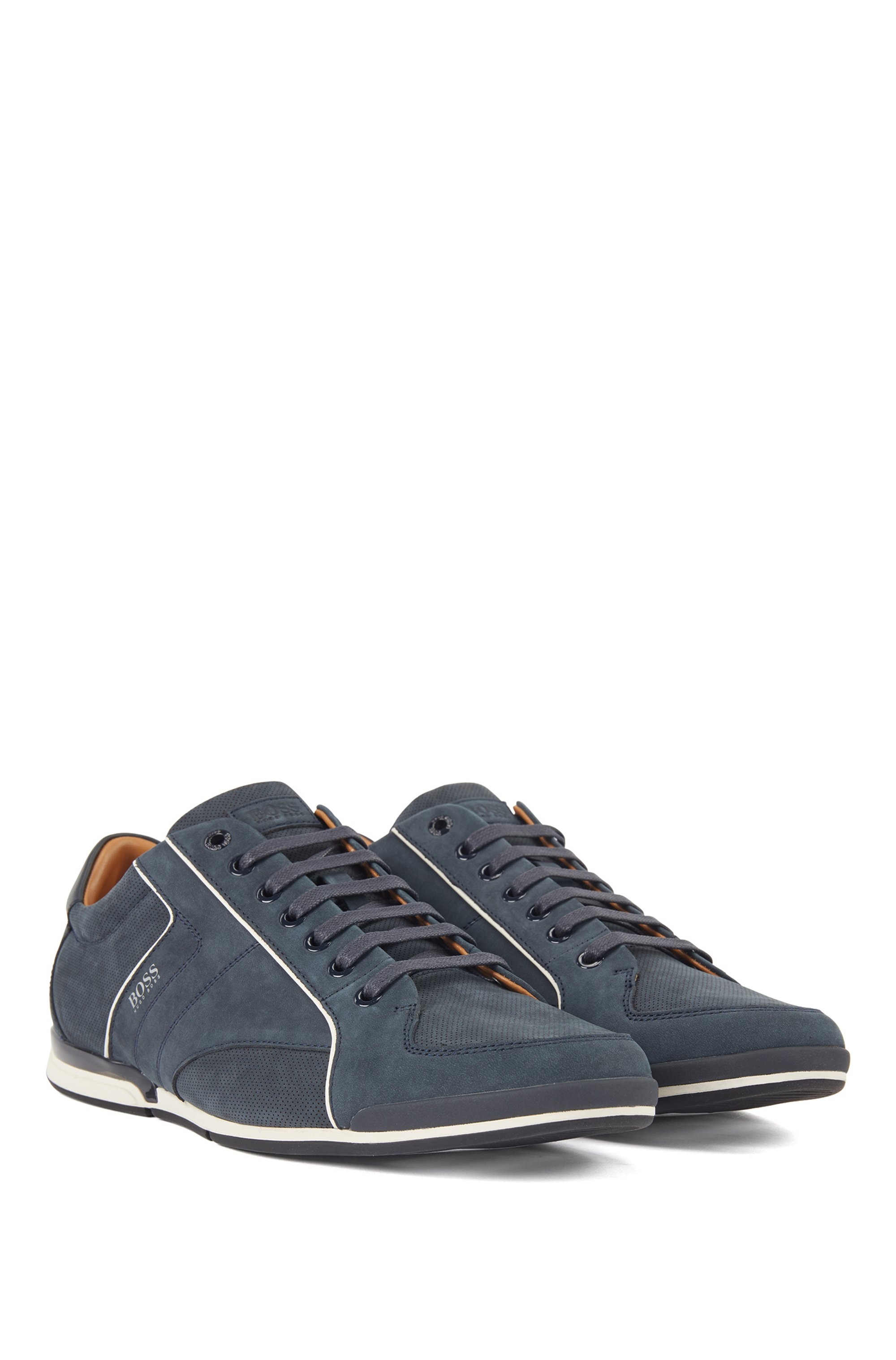Low-top trainers in mixed leather with perforated panels