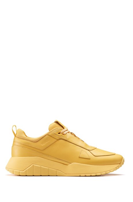 Running-style trainers in tonal nappa leather and mesh, Yellow