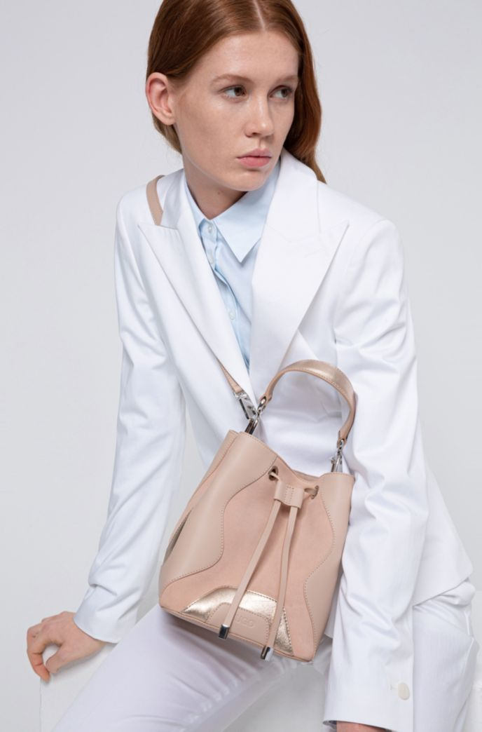 Drawstring-close bucket bag in leather and suede