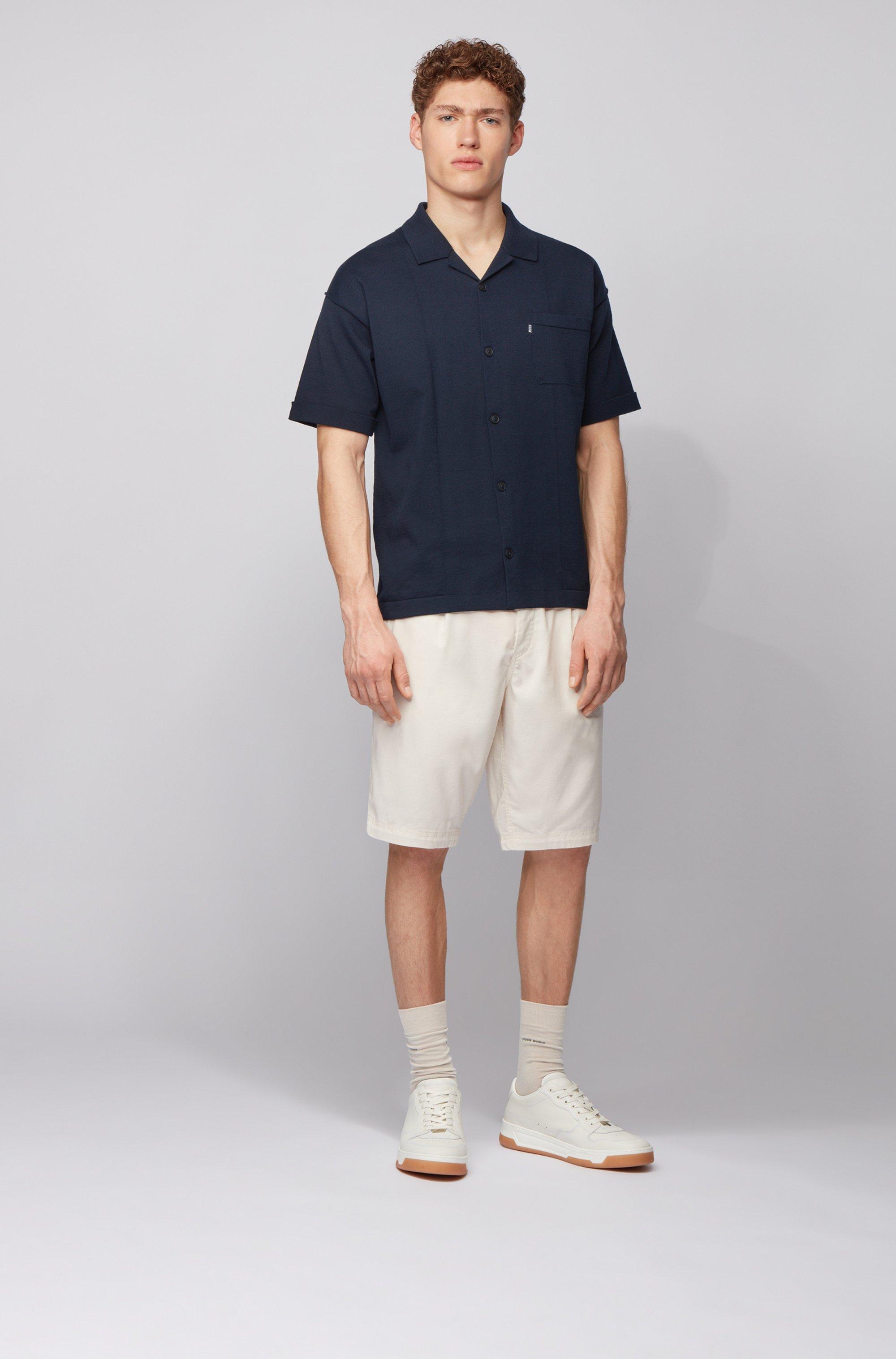 Kurzarm-Strickjacke aus Baumwolle mit aufgesetzter Tasche