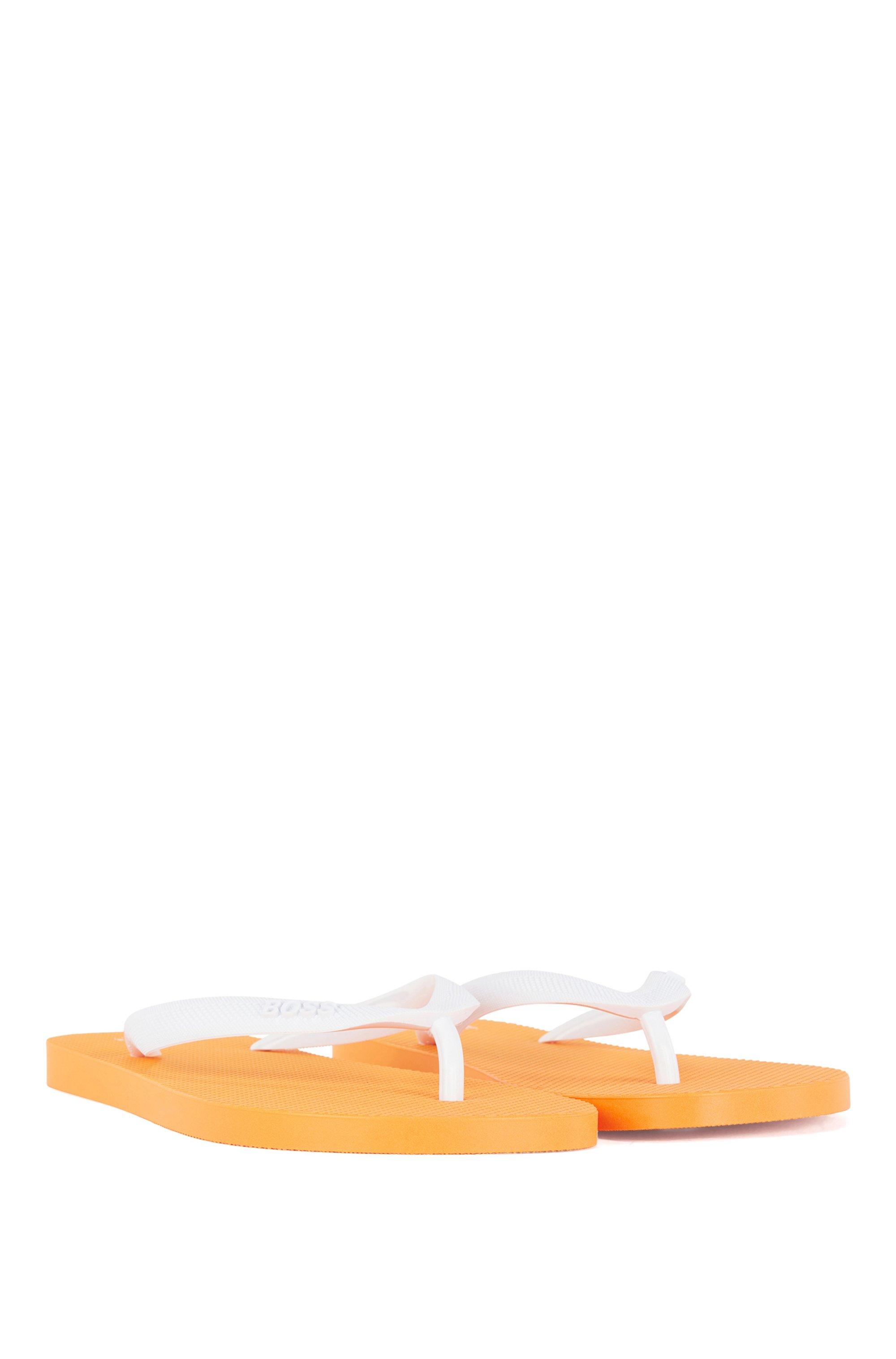 Rubber flip-flops with new-season logo