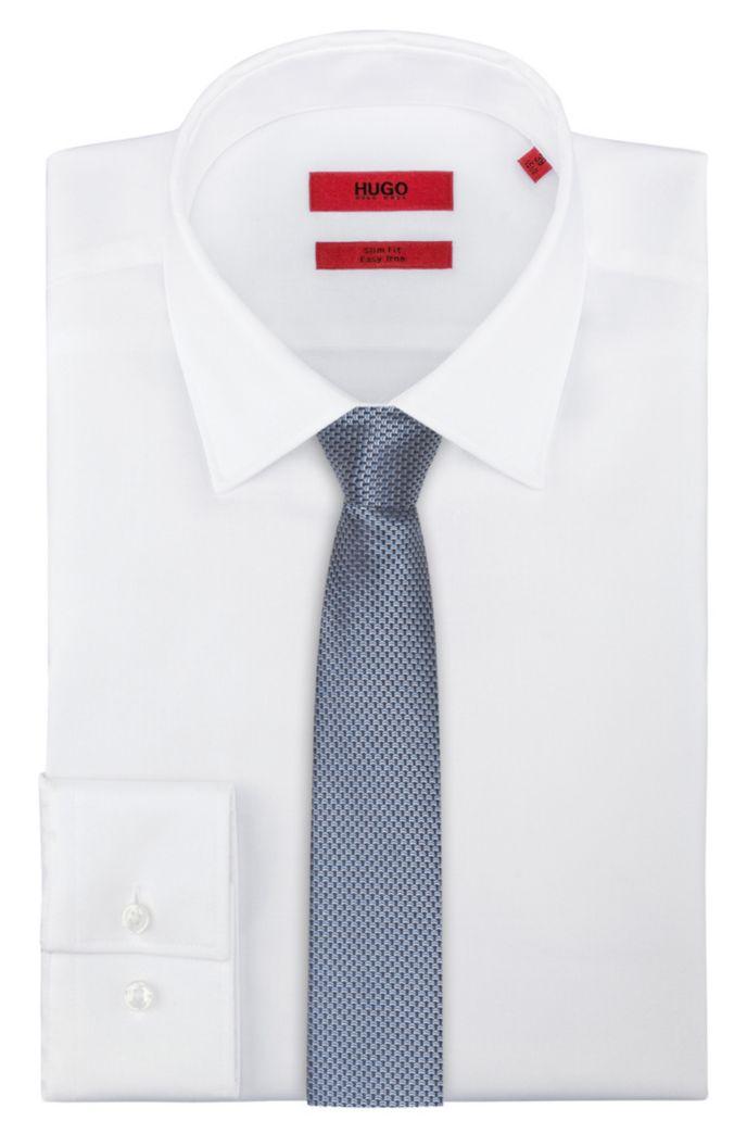 Cravate en soie à micromotif contrastant