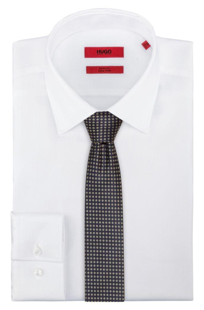 Cravate en jacquard de soie à micromotif contrastant