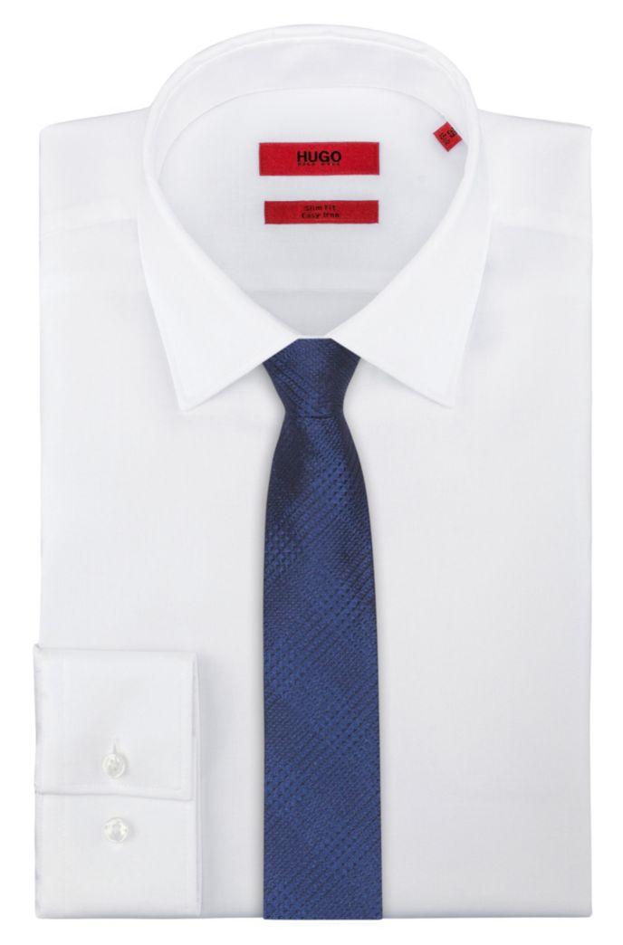 Cravate en jacquard de soie à motif géométrique