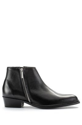 Zipped ankle boots in grained leather with metallic detail, Black