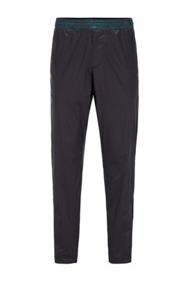 Tapered-fit trousers with printed inserts and zipped hems, Black