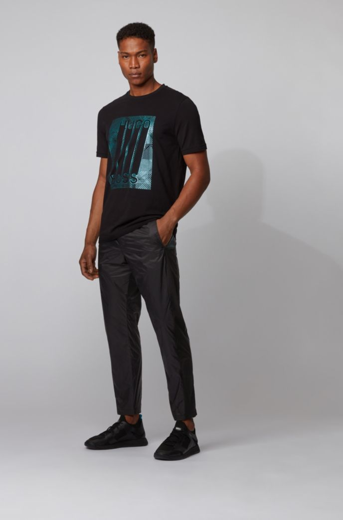 Tapered-fit trousers with printed inserts and zipped hems