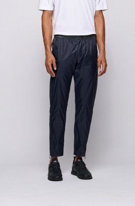 Tapered-fit trousers with printed inserts and zipped hems, Dark Blue