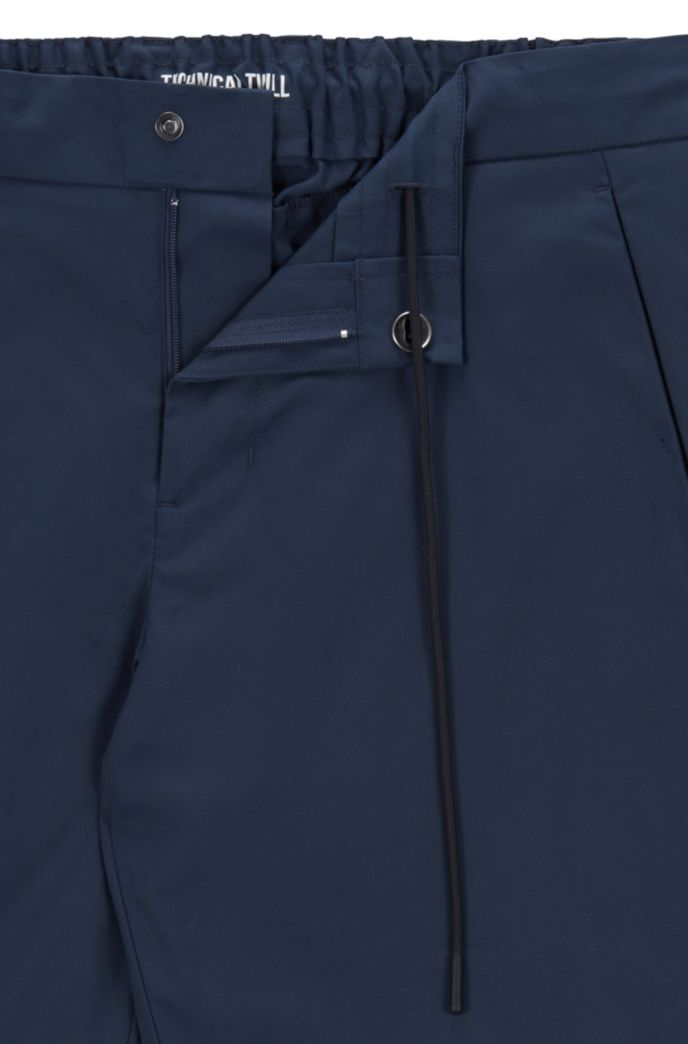 Slim-fit trousers in water-repellent technical twill