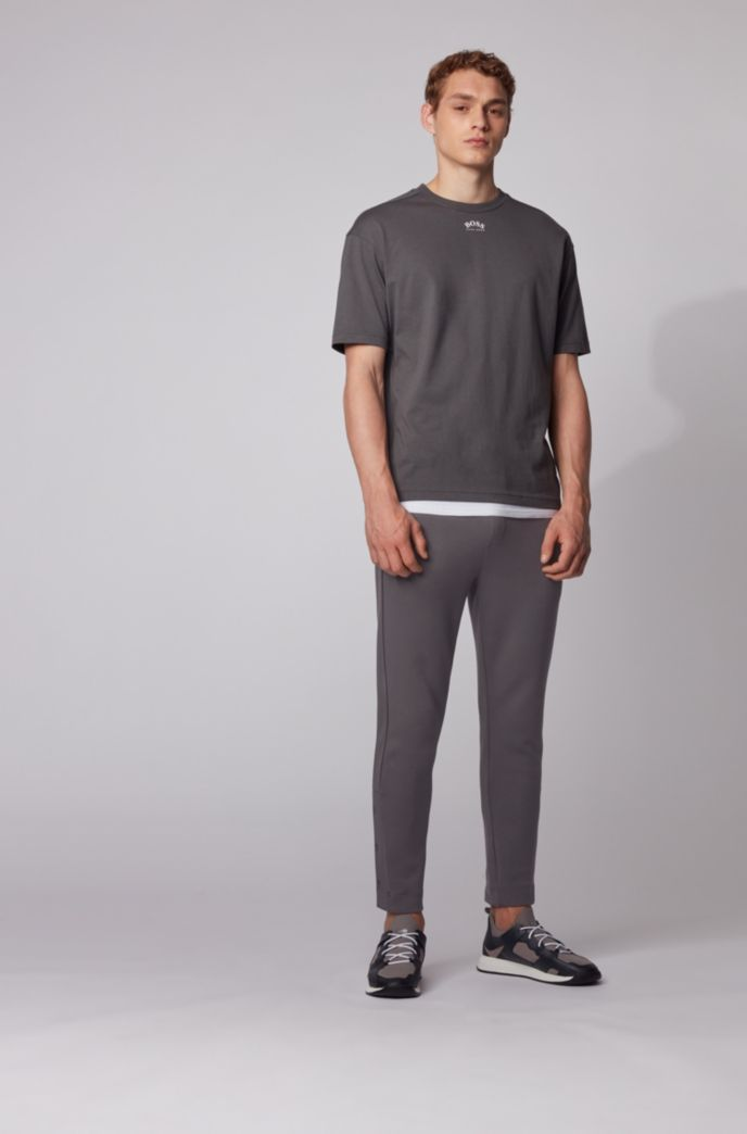 Jogging trousers in stretch fabric with press-stud hems