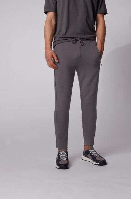 Pantaloni da jogging in tessuto elasticizzato con bottoni automatici sugli orli, Grigio scuro