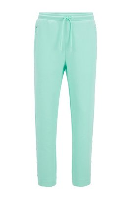 Jogging trousers in stretch fabric with press-stud hems, Light Green