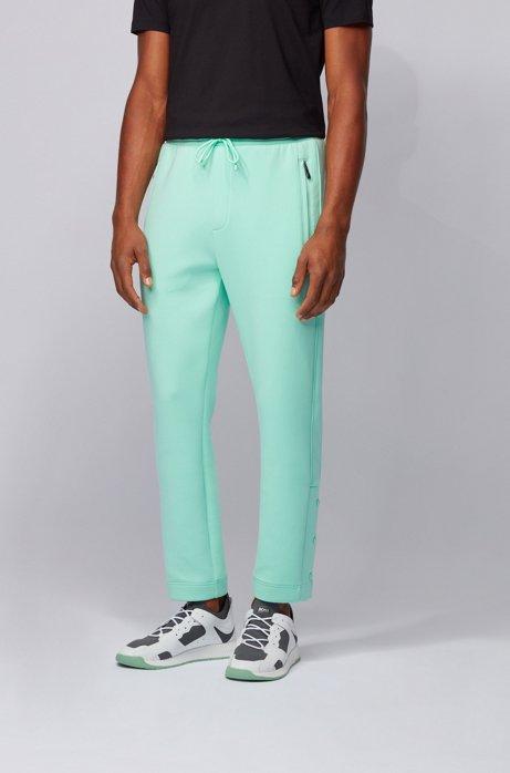Pantaloni da jogging in tessuto elasticizzato con bottoni automatici sugli orli, Calce