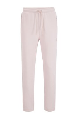 Jogging trousers in stretch fabric with press-stud hems, light pink