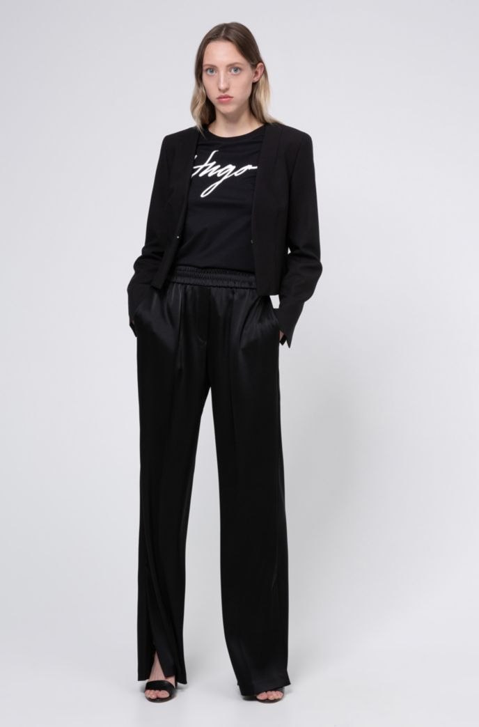 Wide-leg trousers in lustrous fabric with hem slits