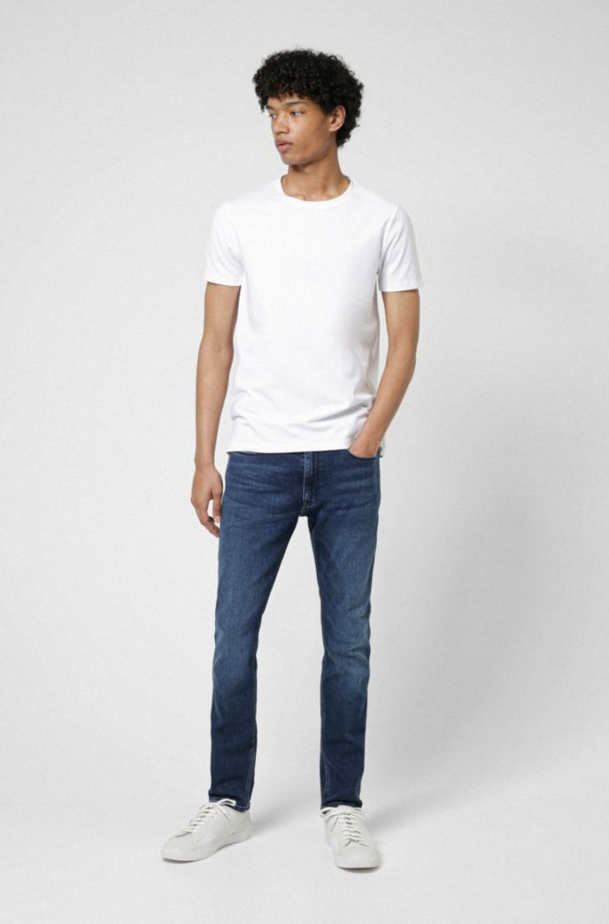 Mid-blue skinny-fit jeans in used-effect stretch denim