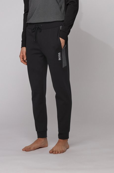 Cuffed jogging trousers in knitted piqué with contrast inserts, Black