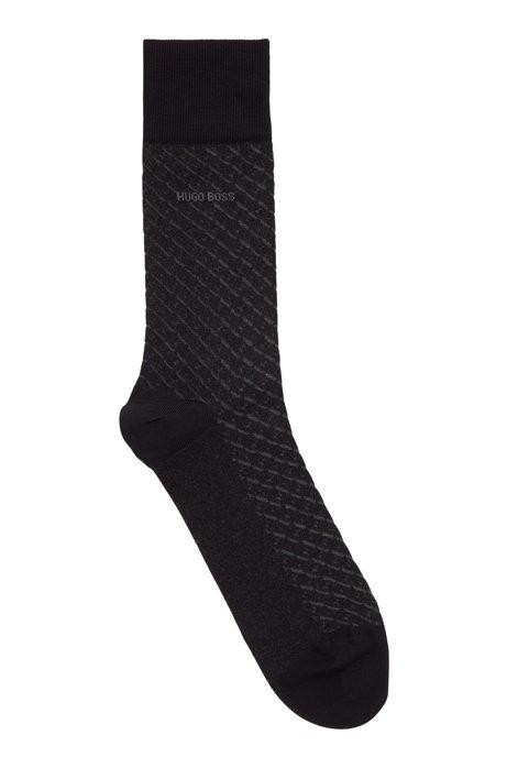 Socken aus merzerisierter Stretch-Baumwolle mit dezentem Muster, Schwarz