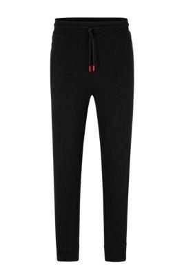 Joggingbroek van katoenen sweatstof met contraststreep en logo, Zwart