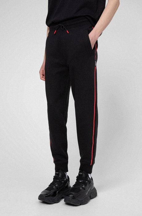 Cotton-terry jogging trousers with contrast stripe and logo, Black