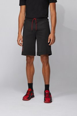 Regular-Fit Shorts aus Interlock-Piqué mit Tokio-Artwork, Schwarz