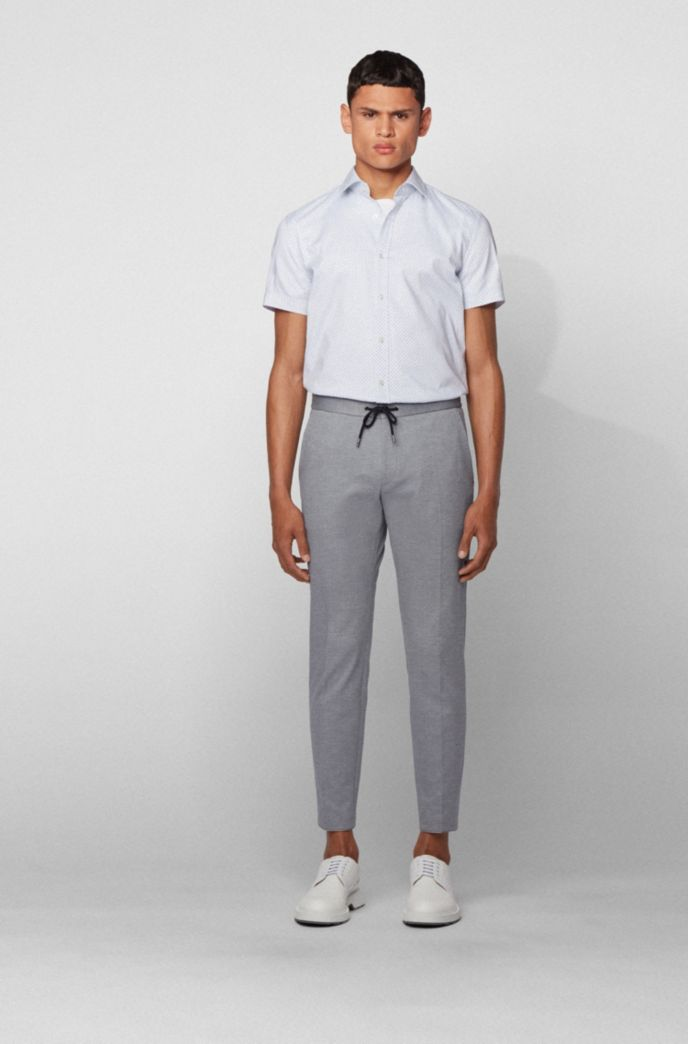 Slim-fit trousers in stretch fabric with elasticated waistband