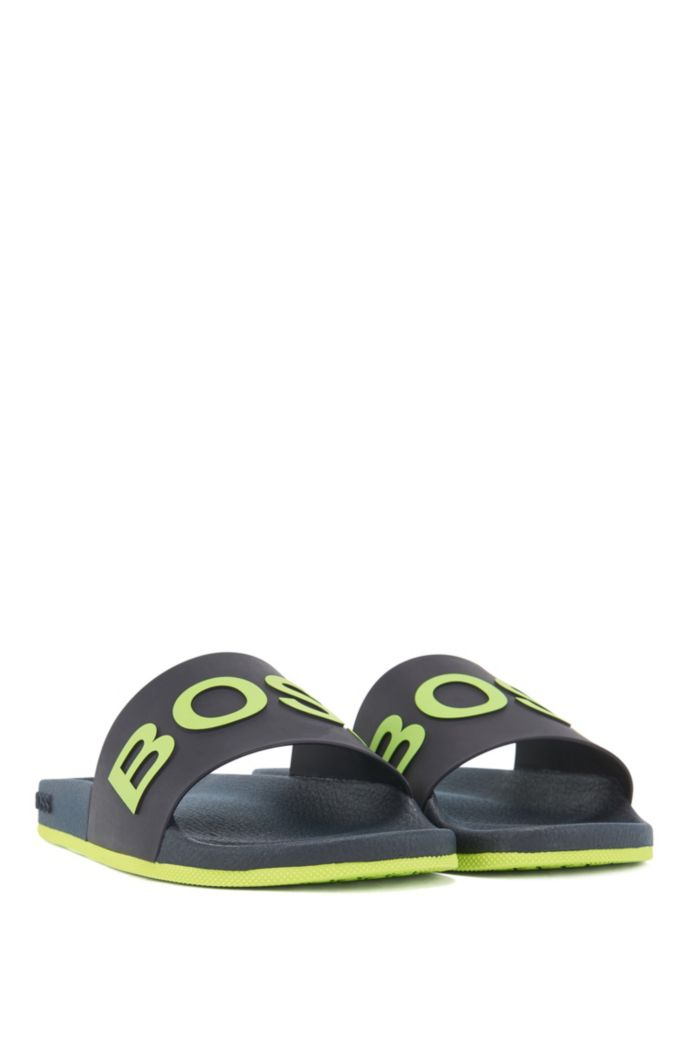Logo slides with monogram-embossed outsole
