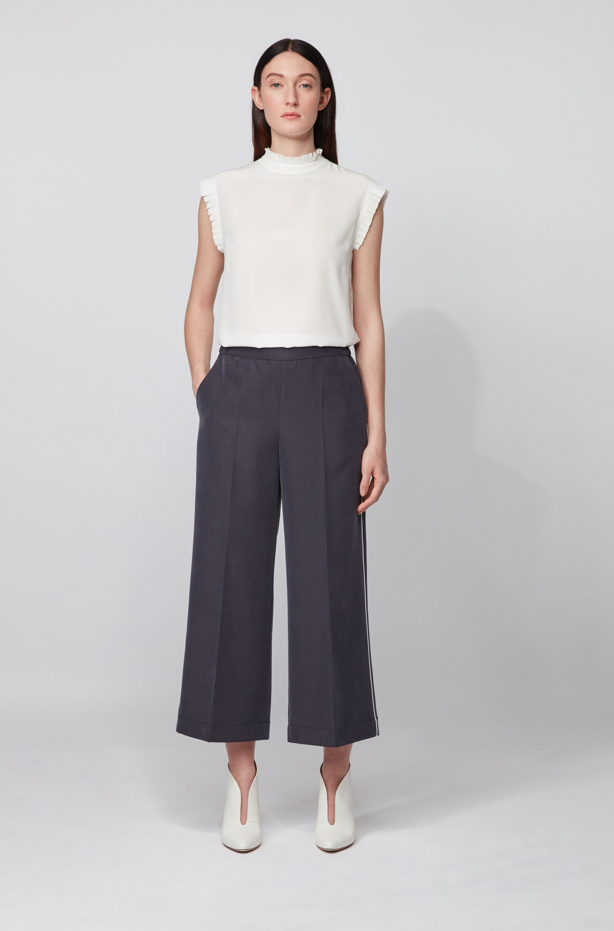 Wide-legged jogging trousers in a sand-washed modal blend