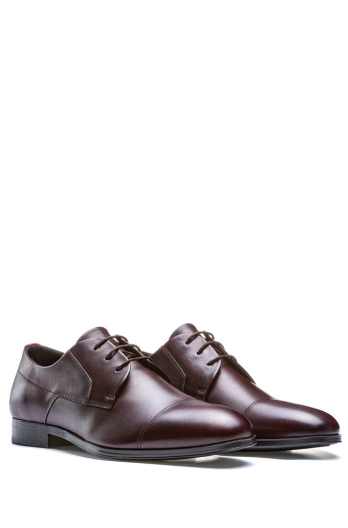 Polished-leather Derby shoes with stitch detailing