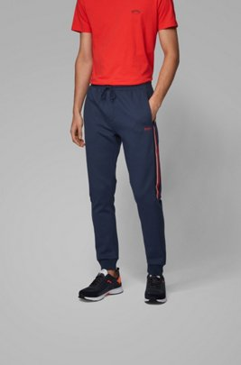 Jogging trousers in piqué fabric with side stripes, Dark Blue