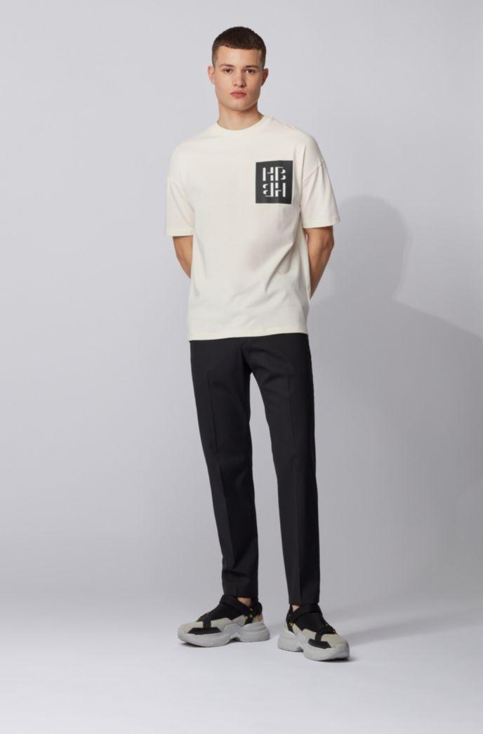 T-shirt van katoenen jersey met gemengde grafische monogramprint