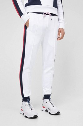 Unisex jogging trousers with side stripes and double waistband, White