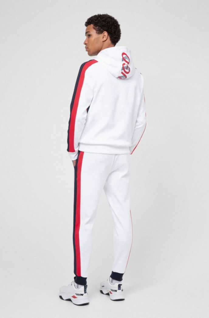 Unisex jogging trousers with side stripes and double waistband
