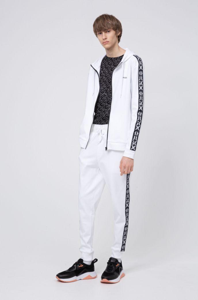 Jersey broek met boorden en band met afgesneden logo