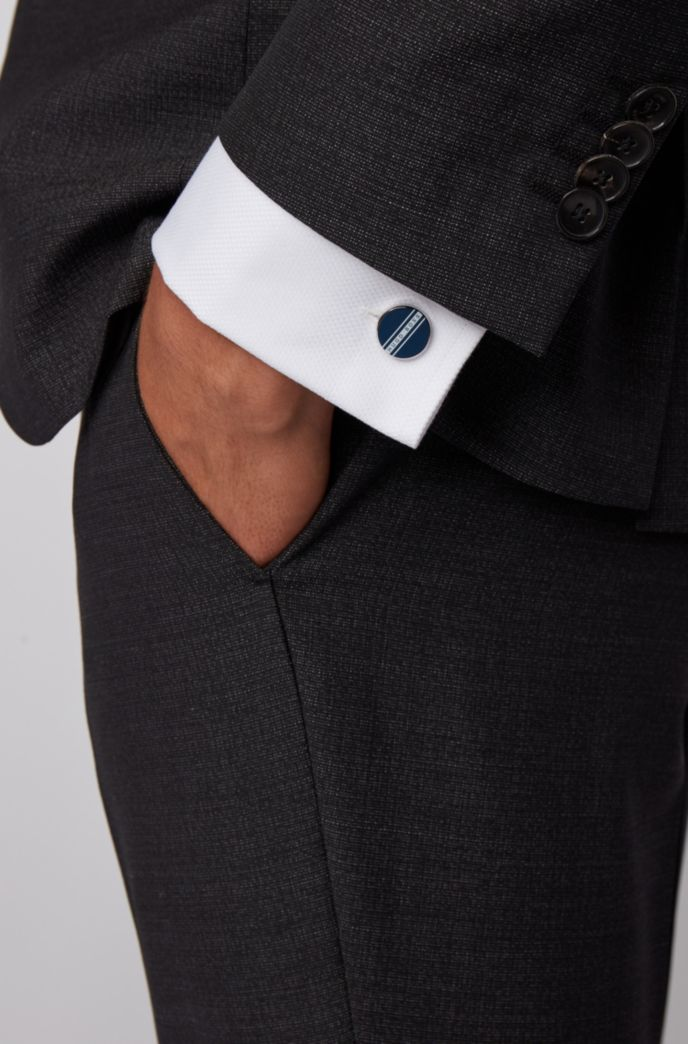 Round cufflinks with stripe and logo