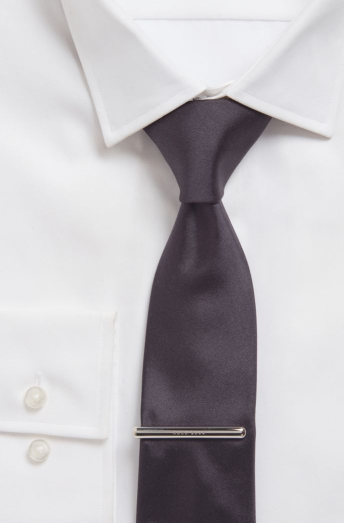 High-shine tie clip with logo detail