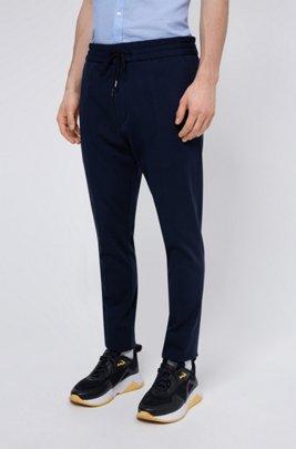 Pantalon Tapered Fit en jersey à rayures tennis et cordon de serrage, Bleu foncé