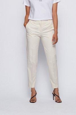 Pantaloni relaxed fit in cotone elasticizzato con gamba affusolata, Bianco
