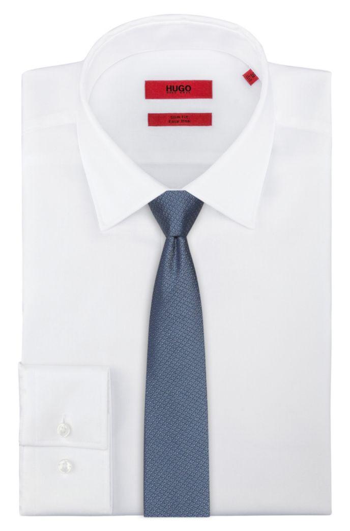 Cravate en jacquard de soie à micromotif triangle