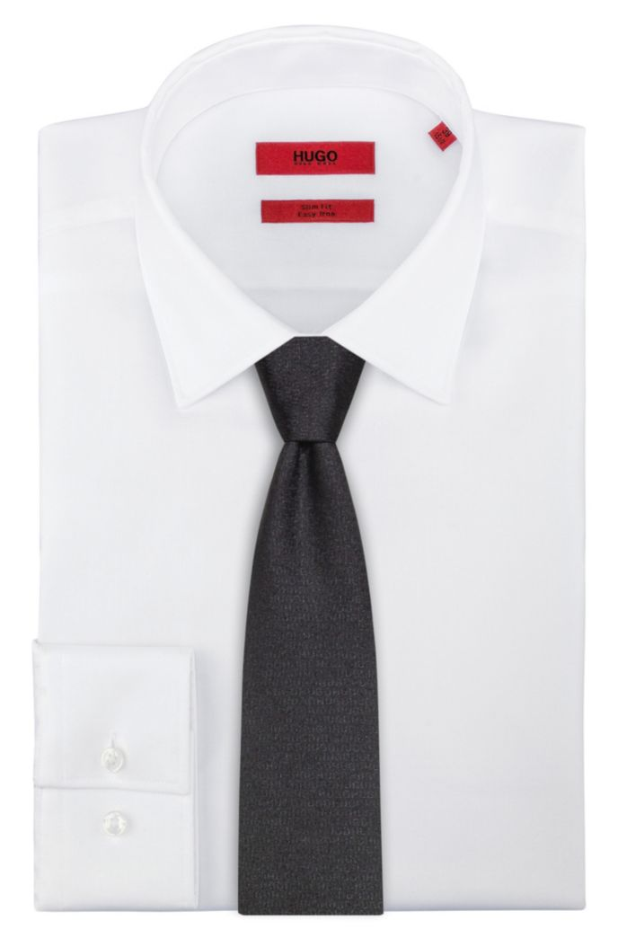 Silk-jacquard tie with all-over logo motif