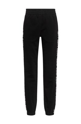 Cotton-blend relaxed-fit trousers with logo inserts, Black