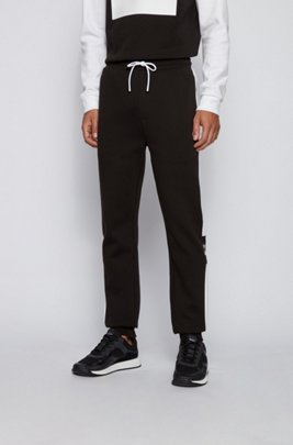 Jogging trousers in double-faced jersey with logo details, Black