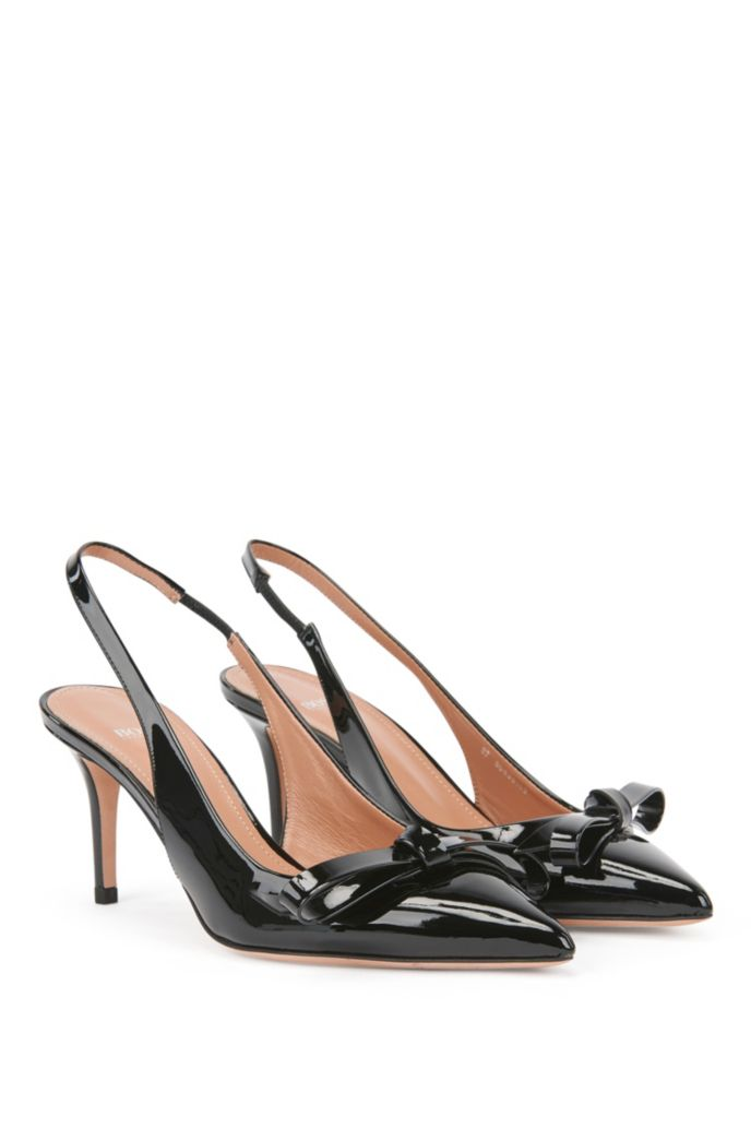 Slingback pumps in patent Italian leather with bow detail