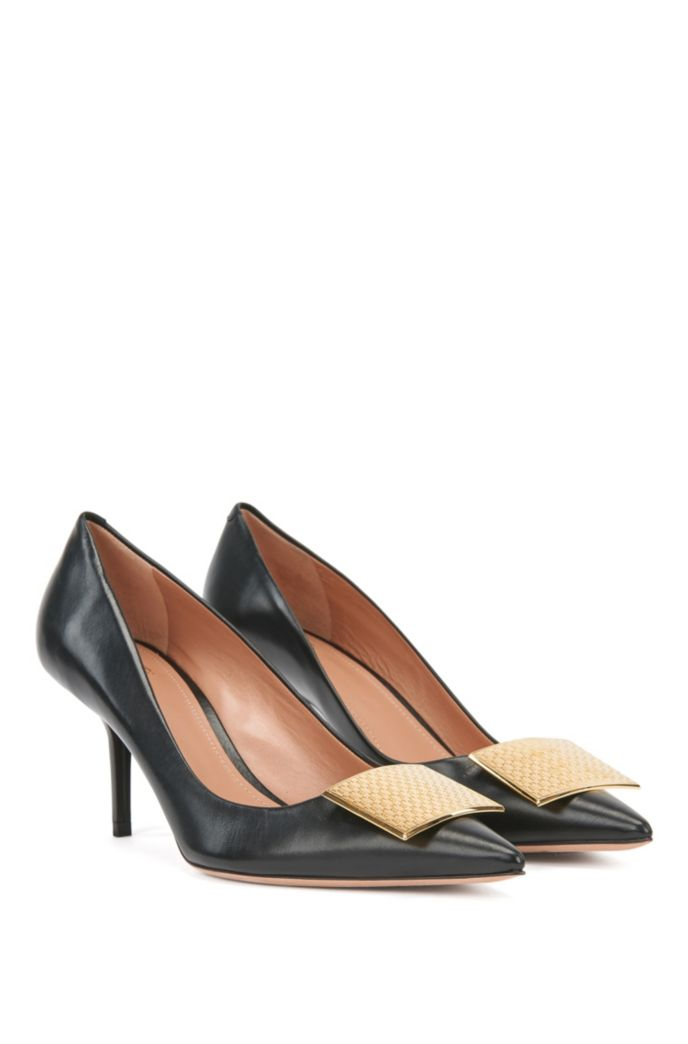 Heeled pumps in Italian leather with monogrammed hardware