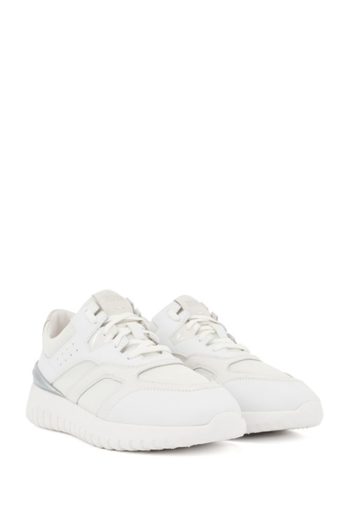 Lace-up trainers with mixed-material uppers