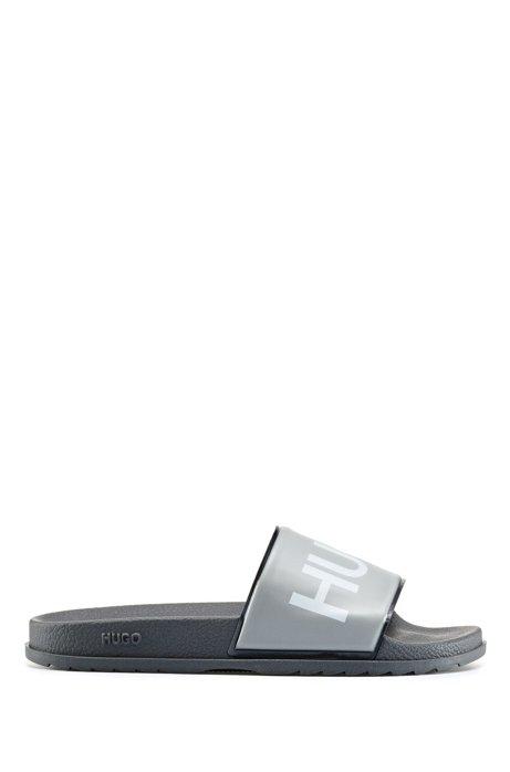 Slides mit Logo-Print und konturiertem Fußbett, Hellblau