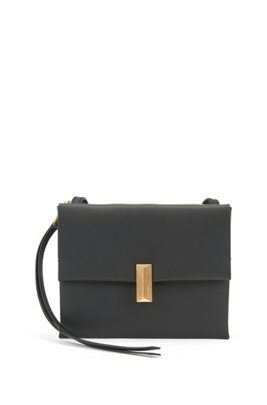 Cross-body bag in coated leather with pyramid hardware, Black