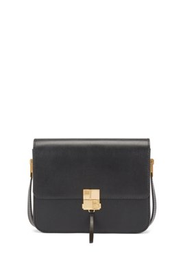 Shoulder bag in coated leather with monogram closure, Black